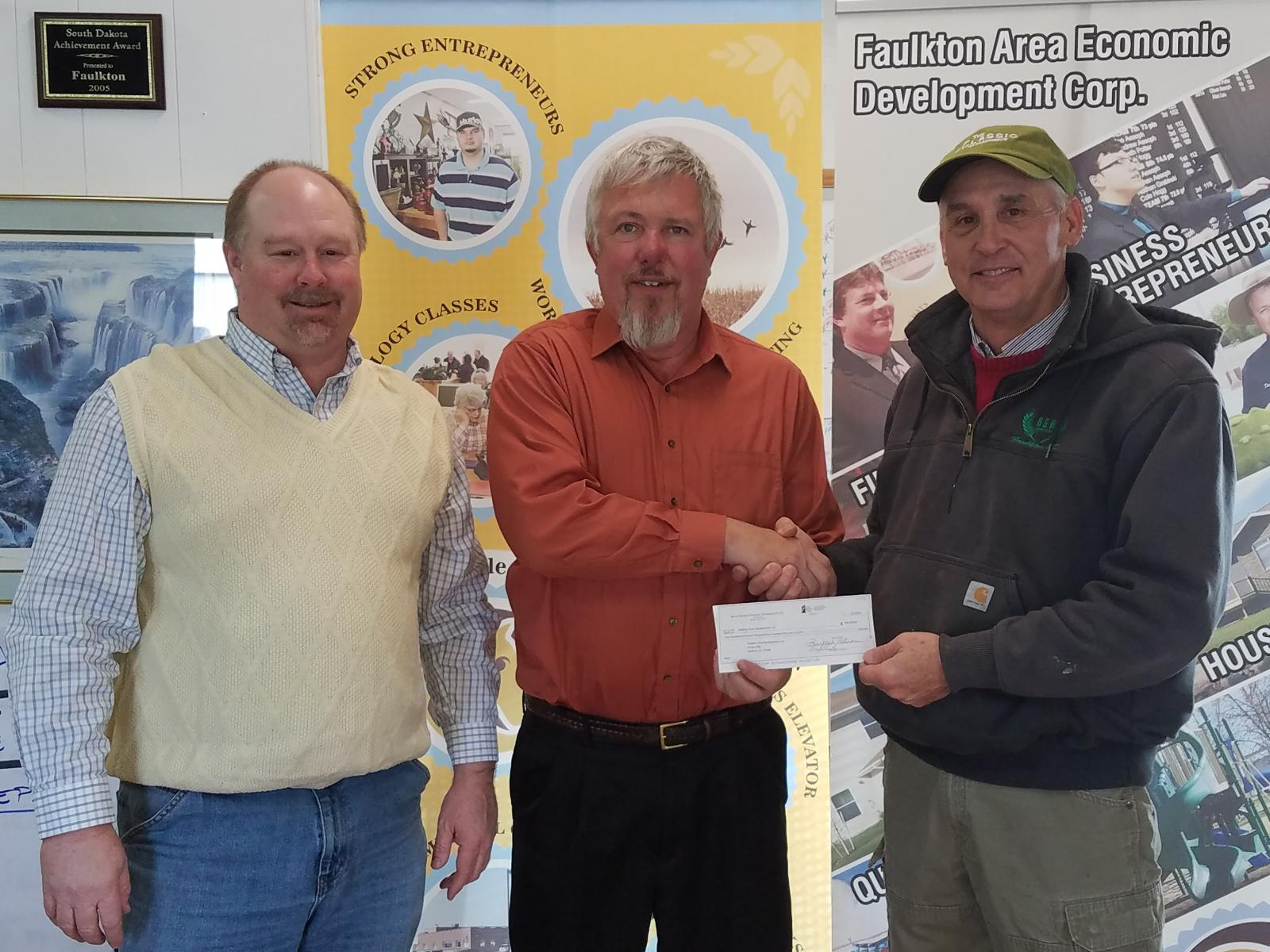 FEM General Manager Scott Moore presents a check to representatives from the Faulkton Area Economic Development Corporation at the loan closing