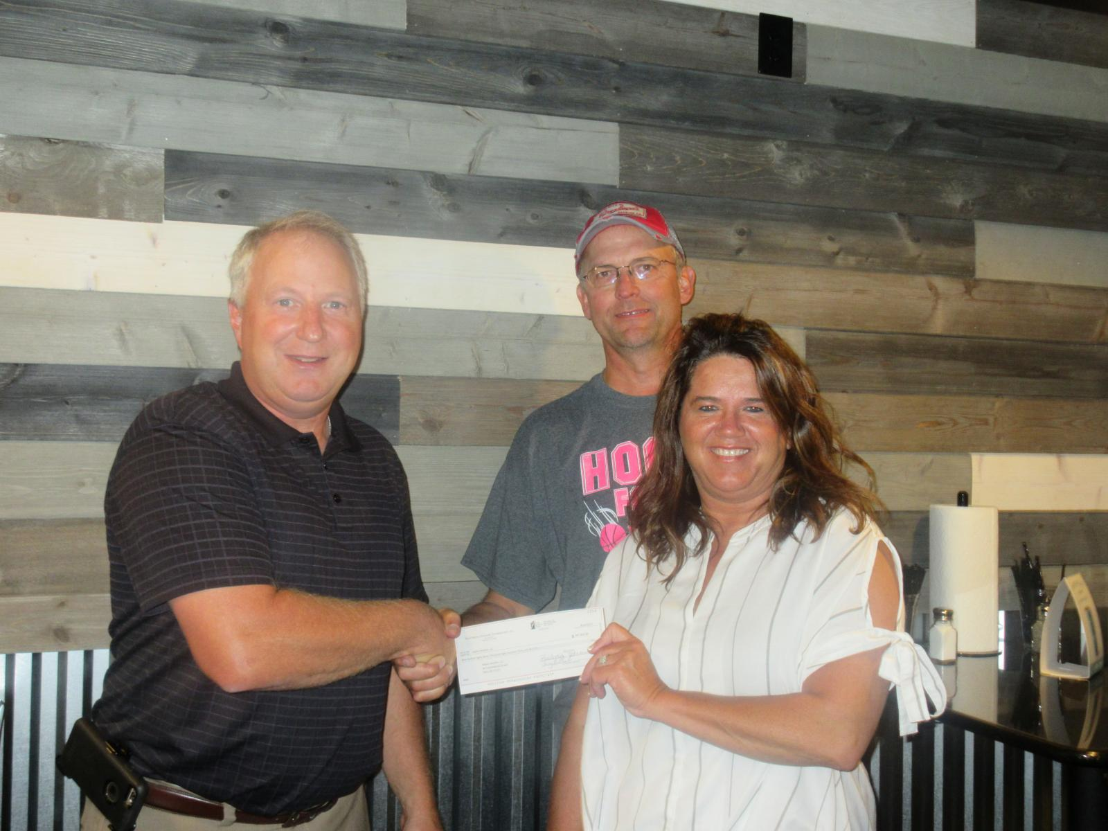 Dave Eide, Codington Clark Electric Manager, presents check to Dakota Butchers