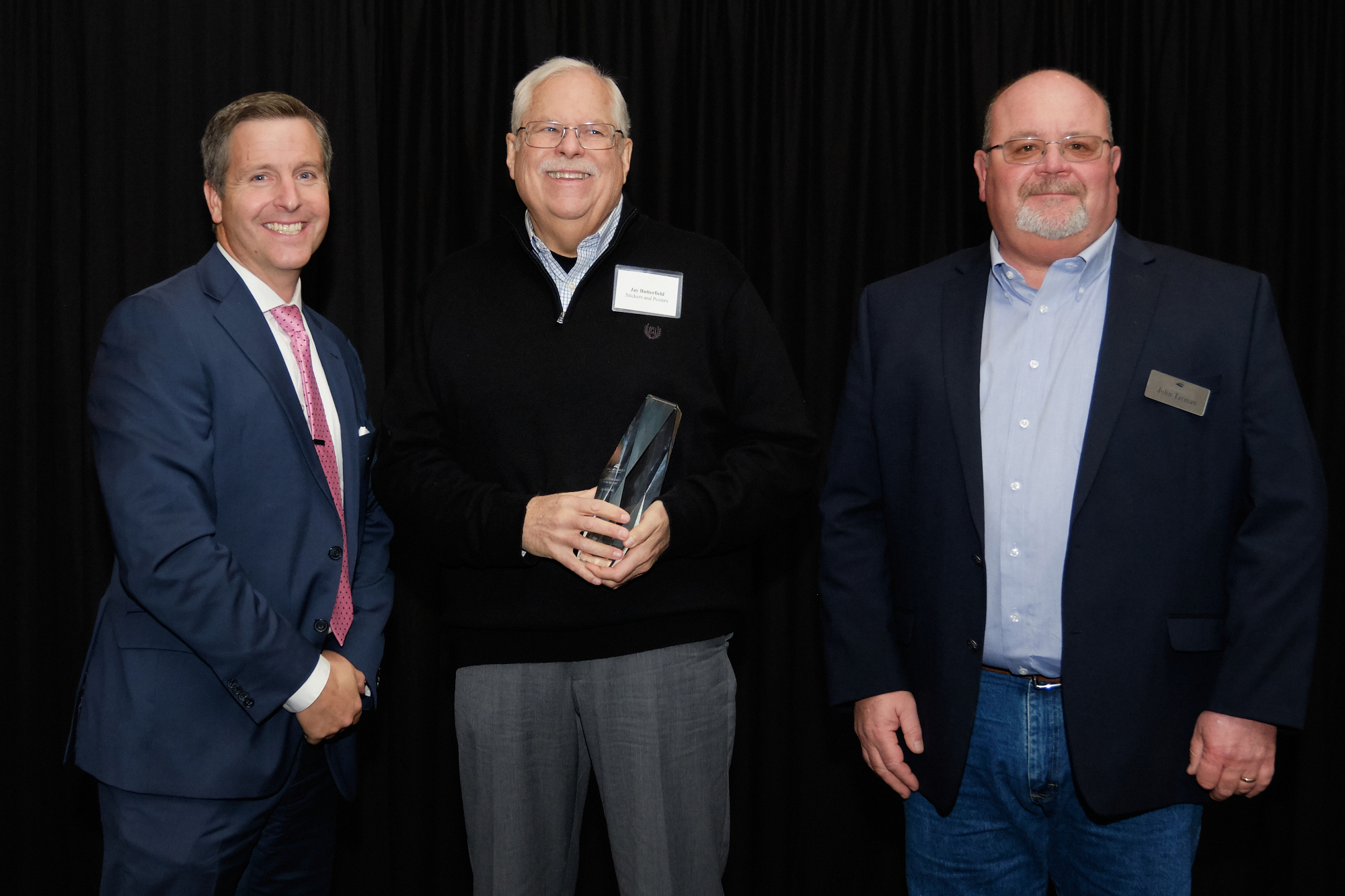 L to R: Corridor CEO Kiley Miller, 2019 Entrepreneur of the Year Jay Butterfield (Stickers and Posters), Corridor Board Chair John Tatman