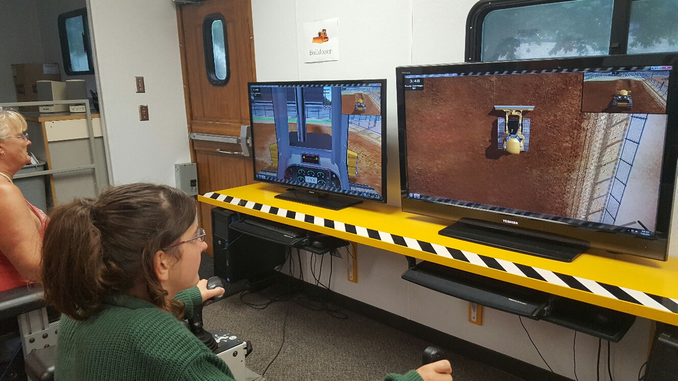 The heavy equipment simulator gave the public a chance to operate different types of construction machinery.