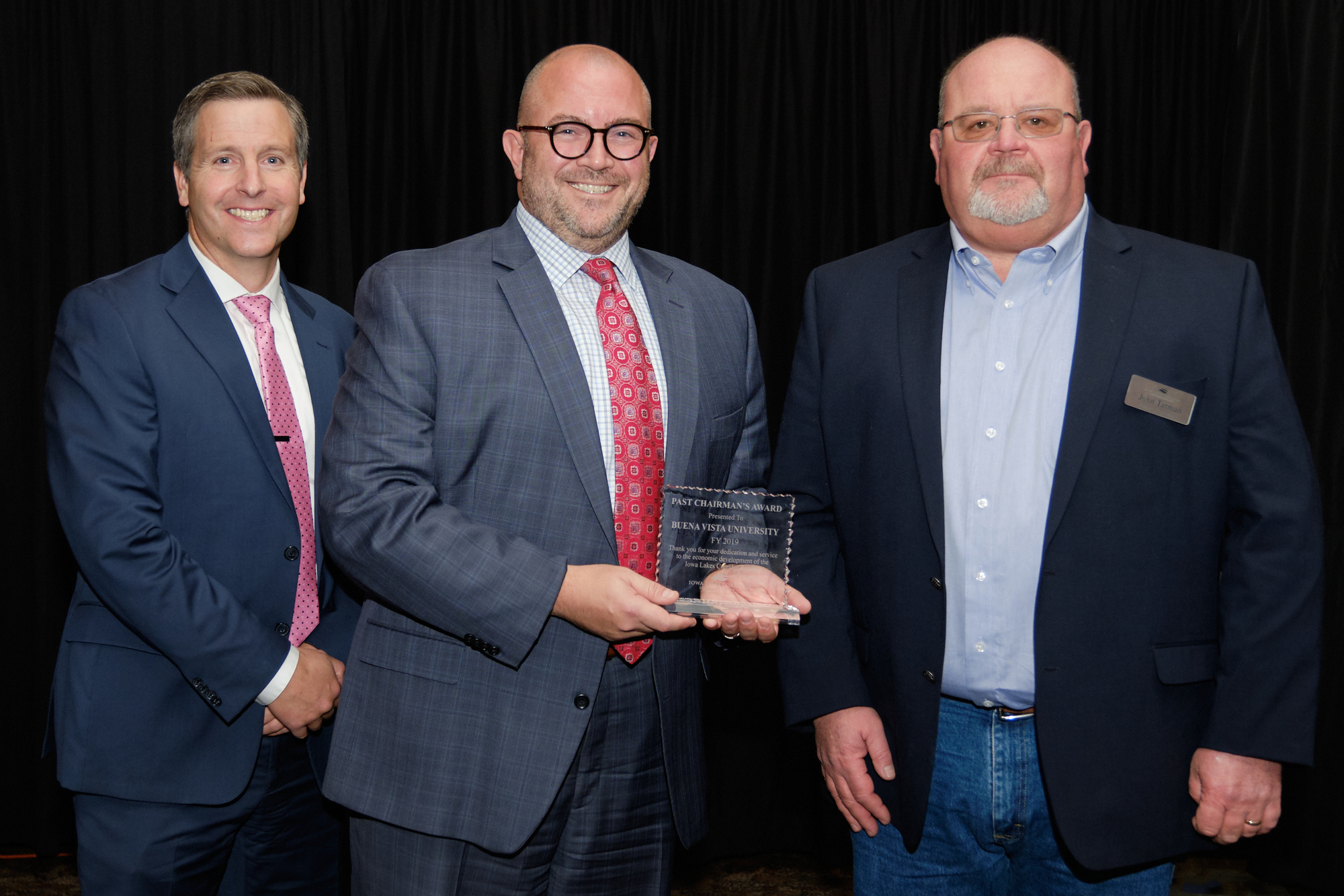 L to R: Corridor CEO Kiley Miller, Dr. Joshua Merchant of Buena Vista University - 2019 Chairman's Award Winner, Corridor Board Chair John Tatman