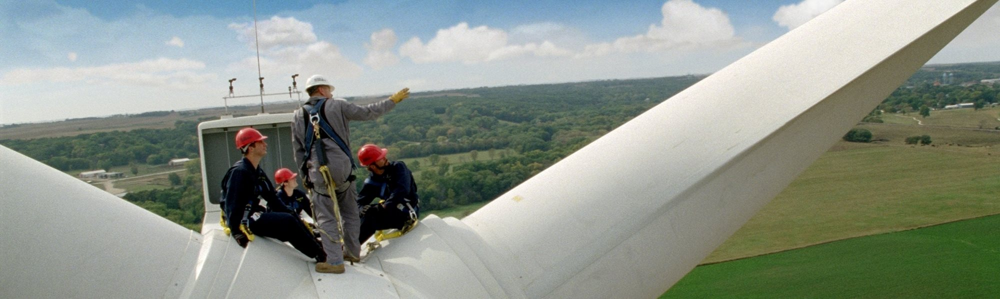 Instructor and students on top of wind turbine